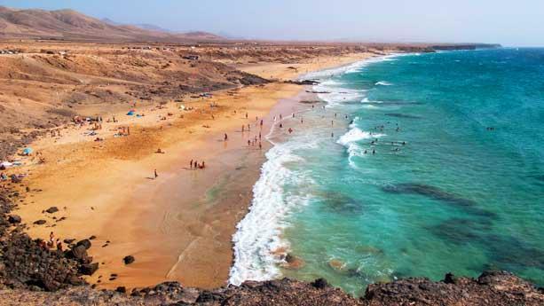 Surfers beach piedra playa el cotillo